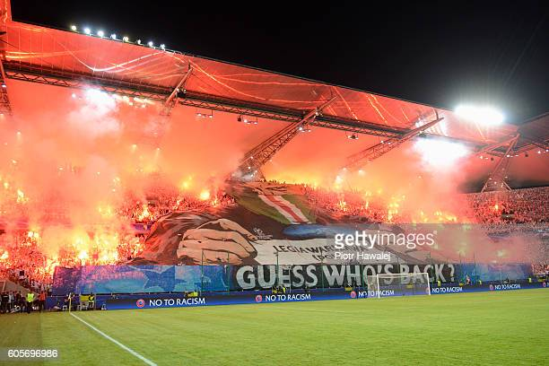 Fans of Legia Warszawa in action during the UEFA Champions League match between Legia Warszawa and Borussia Dortmund at Wojska Polskiego Stadium on...