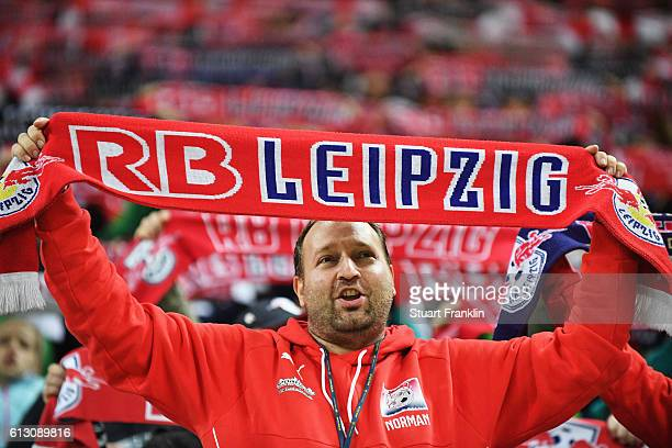 Fans of Leipzig show their support during the Bundesliga match between RB Leipzig and FC Augsburg at Red Bull Arena on September 30 2016 in Leipzig...
