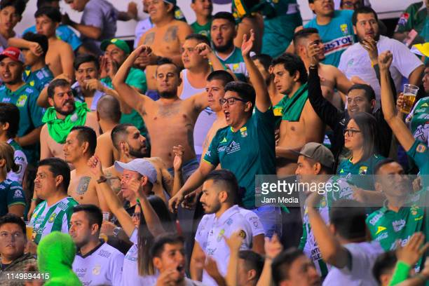 Fans of Leon cheer for their team during the semifinals first leg match between America and Leon as part of the Torneo Clausura 2019 Liga MX at...