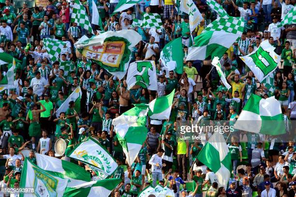 Fans of Leon cheer on there team during the 8th round match between Leon and Pumas UNAM as part of the Torneo Apertura 2018 Liga MX at Leon Stadium...