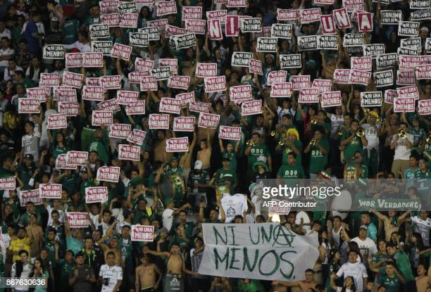 Fans of Leon demonstrate against feminicide during the Mexican Apertura football tournament match between Leon and Veracruz at the Nou Camp stadium...