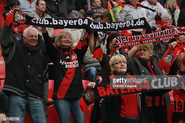 Fans of Leverkusen celebrate during the Bundesliga match between Bayer 04 Leverkusen and Borussia Moenchengladbach at BayArena on March 2012 in...