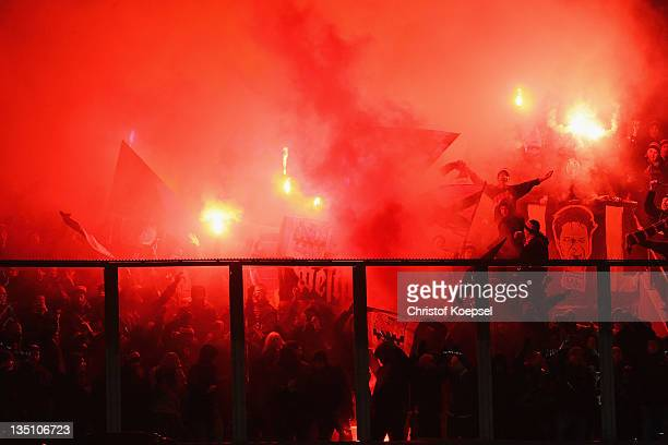 Fans of Leverkusen throw smokebombs during the UEFA Champions League group E match between KRC Genk and Bayer 04 Leverkusen at Cristal Arena on...