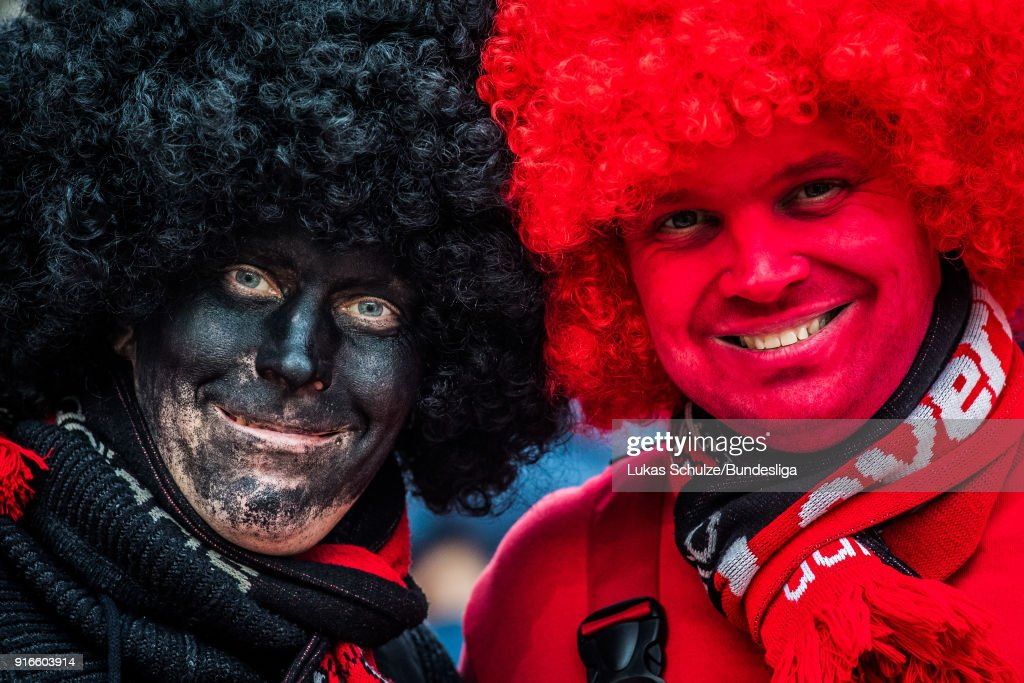 Fans of Leverkusen wear costumes and stay together prior to the Bundesliga match between Bayer 04 Leverkusen and Hertha BSC at BayArena on February 10, 2018 in Leverkusen, Germany.