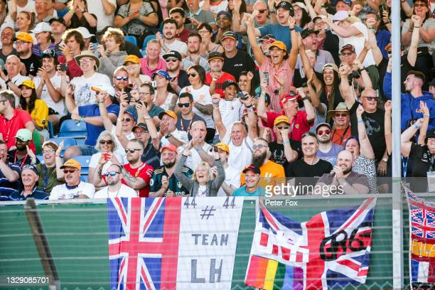 Fans of Lewis Hamilton celebrate him taking Pole Position during practice/qualifying ahead of the F1 Grand Prix of Great Britain at Silverstone on...
