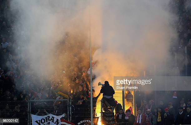Fans of Liege light a flare during the UEFA Europa League quarter final first leg match between Hamburger SV and Standard Liege at HSH Nordbank Arena...