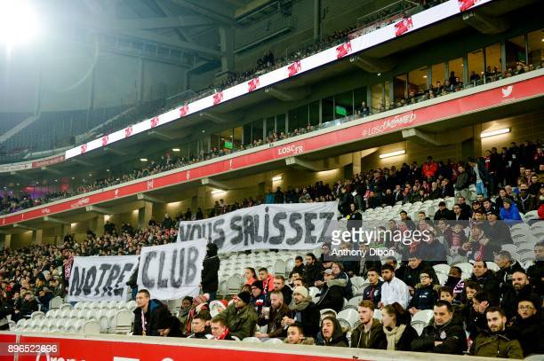 Fans of Lille protest against the team during the Ligue 1 match between Lille OSC and OGC Nice at Stade Pierre Mauroy on December 20 2017 in Lille