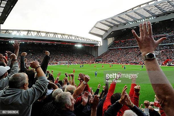 Fans of Liverpool celebrate after Roberto Firmino scores the fourth during the Premier League match between Liverpool and Leicester City at Anfield...