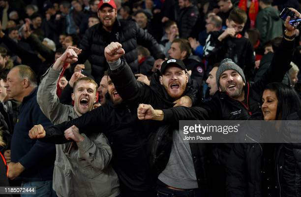 Fans of Liverpool celebrate the win at the end of the Premier League match between Aston Villa and Liverpool FC at Villa Park on November 02 2019 in...