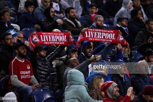 Fans of Liverpool FC celebrate their team victory at the end of the UEFA Champions League Round of 16 First Leg match between FC Porto and Liverpool...