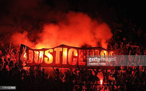 Fans of Liverpool hold up a banner that reads 'Justice for the 96' during the Pre Season match between Indonesia XI and Liverpool at Gelora Bug Karno...