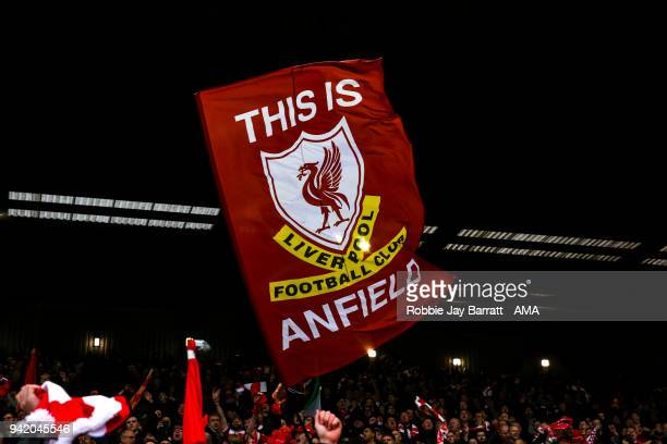 Fans of Liverpool hold up a flag during the UEFA Champions League Quarter Final first leg match between Liverpool and Manchester City at Anfield on...