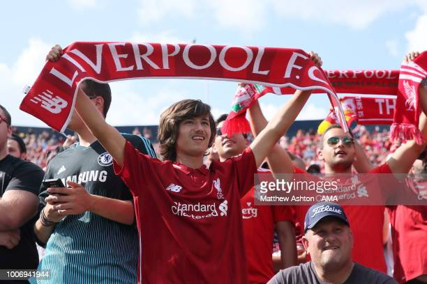 Fans of Liverpool hold up scarfs whilst singing You'll Never Walk Alone during the International Champions Cup 2018 match between Manchester Untied...