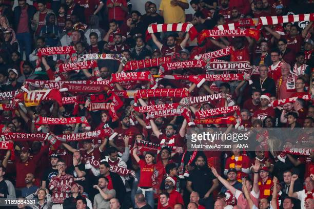 Fans of Liverpool hold up scarves during the FIFA Club World Cup Qatar 2019 Final match between Liverpool FC and CR Flamengo at Khalifa International...