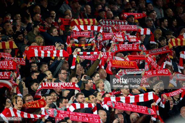 Fans of Liverpool hold up scarves during the Premier League match between Liverpool FC and Watford FC at Anfield on February 27 2019 in Liverpool...