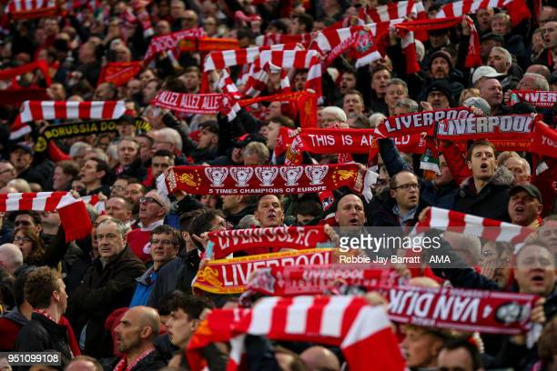 Fans of Liverpool hold up scarves during the UEFA Champions League Semi Final First Leg match between Liverpool and AS Roma at Anfield on April 24...