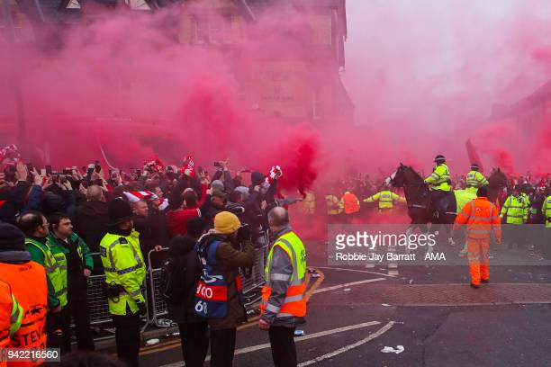 Fans of Liverpool let of flares as the Liverpool team bus arrives prior to the UEFA Champions League Quarter Final first leg match between Liverpool...