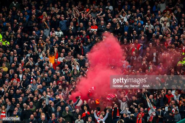 Fans of Liverpool let off a flare during the Premier League match between Manchester United and Liverpool at Old Trafford on March 10 2018 in...