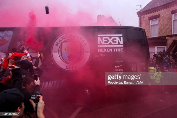 Fans of Liverpool react and throw objects as the Manchester City team bus arrives prior to the UEFA Champions League Quarter Final first leg match...