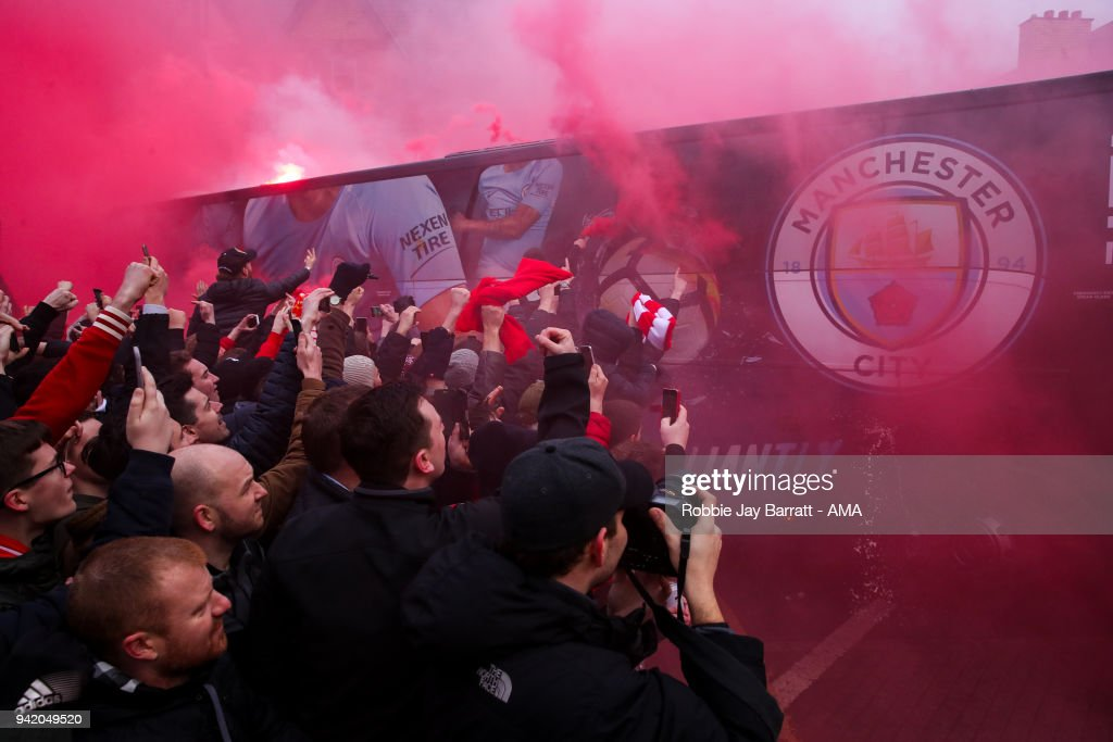 Fans of Liverpool react as the Manchester City team bus arrives prior to the UEFA Champions League Quarter Final first leg match between Liverpool and Manchester City at Anfield on April 4, 2018 in Liverpool, England.