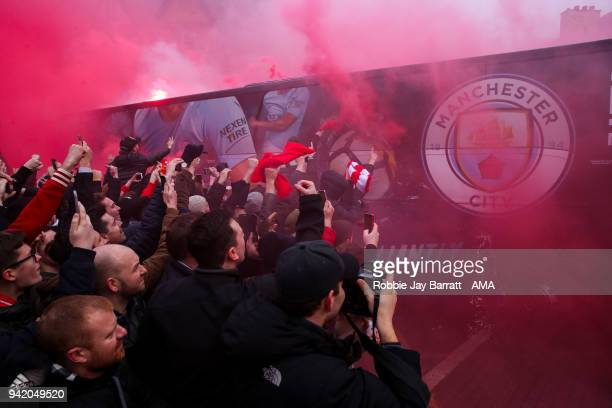 Fans of Liverpool react as the Manchester City team bus arrives prior to the UEFA Champions League Quarter Final first leg match between Liverpool...