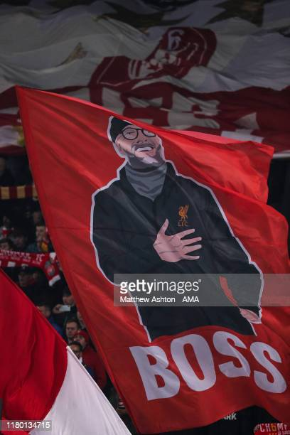 Fans of Liverpool wave a flag of Jurgen Klopp the head coach / manager of Liverpool in The Kop end during the UEFA Champions League group E match...