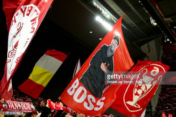 Fans of Liverpool wave flags in The Kop during the Premier League match between Liverpool FC and Sheffield United at Anfield on January 2 2020 in...
