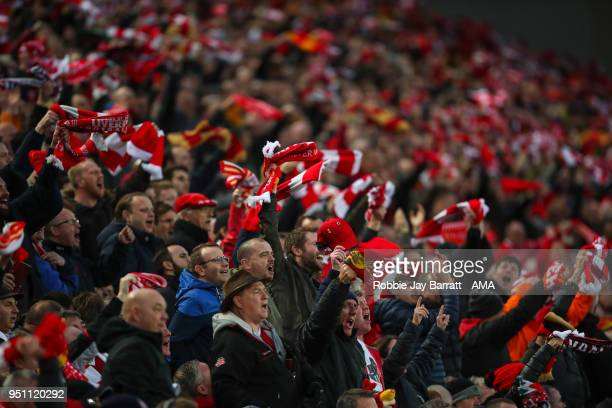 Fans of Liverpool wave scarves during the UEFA Champions League Semi Final First Leg match between Liverpool and AS Roma at Anfield on April 24 2018...