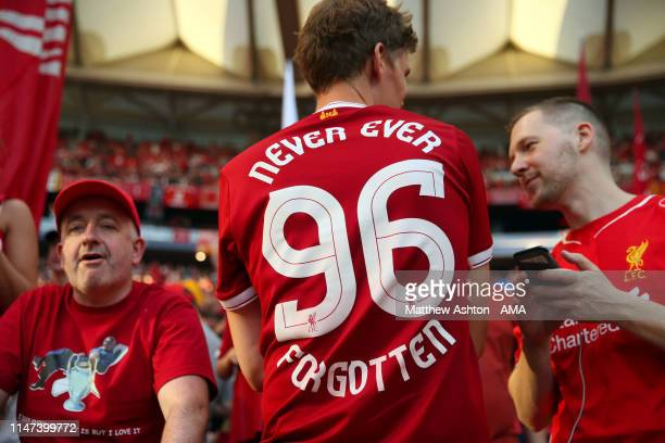 Fans of Liverpool wearing a 96 shirt remembering the Hillsborough Disaster during the UEFA Champions League Final between Tottenham Hotspur and...