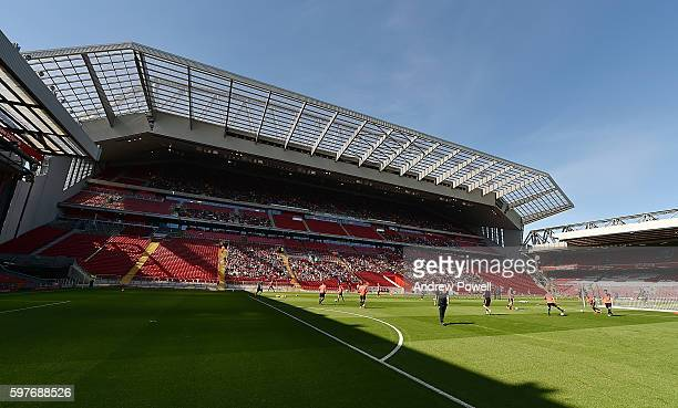 Fans of Liverpool wtach training at the main stand test event at Anfield on August 29 2016 in Liverpool England