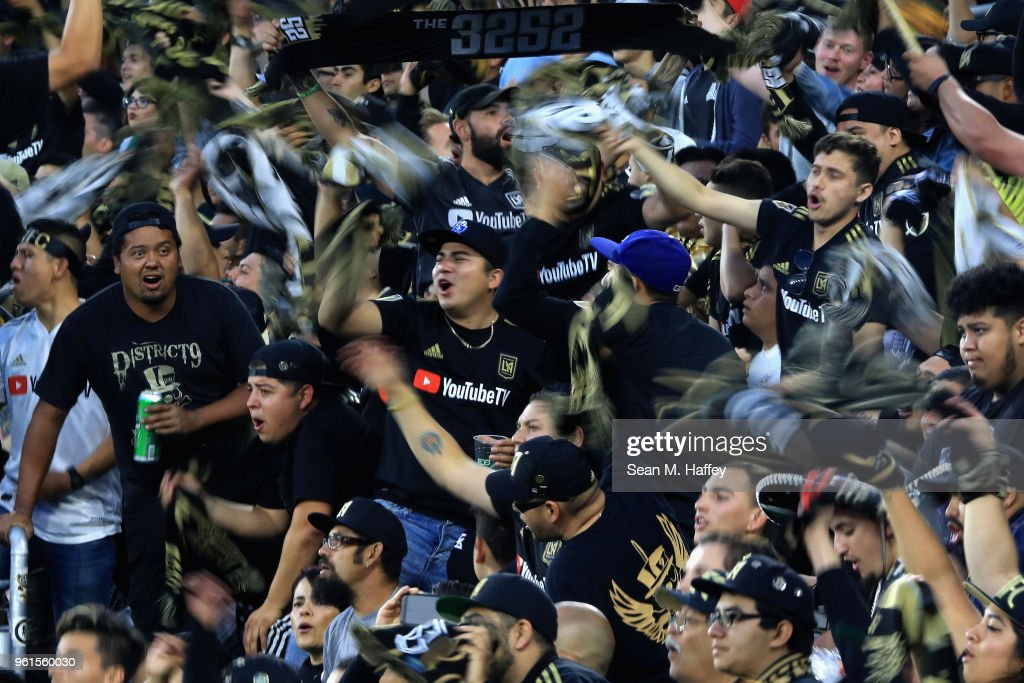 Fans of Los Angeles FC wave flags and chant during the first half of an International friendly soccer match against the Borussia Dortmund at Banc of California Stadium on May 22, 2018 in Los Angeles, California.
