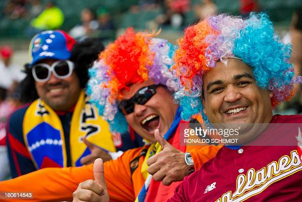 Fans of Magallanes of Venezuela cheer their team before a match against Criollos de Cagua of Puerto Rico during the 2013 Caribbean baseball series on...