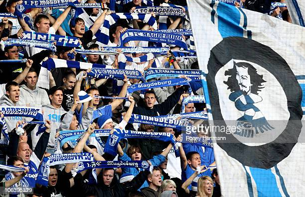 Fans of Magdeburg cheer during the Regionalliga match between FC Magdeburg and Chemnitzer FC at the MDCC Arena on October 31 2010 in Magdeburg Germany