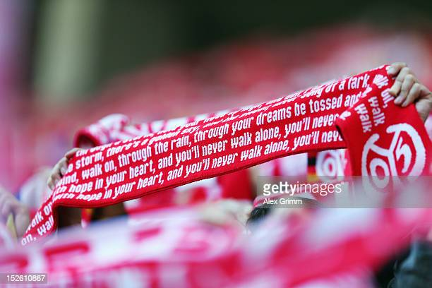 Fans of Mainz hold up their scarfs prior to the Bundesliga match between 1 FSV Mainz 05 and FC Augsburg at Coface Arena on September 22 2012 in Mainz...