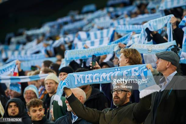 Fans of Malmo FF cheer with scarfs prior to the UEFA Europa League match between Malmo FF and FC Copenhagen at Stadion Malmo on October 3 2019 in...