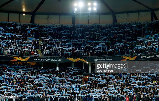 Fans of Malmo FF cheer with scarfs prior to the UEFA Europa League match between Malmo FF and FC Copenhagen at Stadion Malmo on October 3, 2019 in...