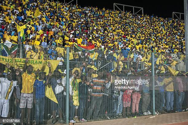 Fans of Mamelodi Sundowns celebrate after winning the semifinal match of CAF Champions League between ZESCO United FC and Mamelodi Sundowns at the...