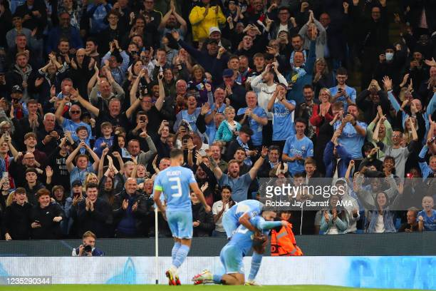 Fans of Manchester City celebrate as Jack Grealish of Manchester City celebrates after scoring a goal to make it 4-2 during the UEFA Champions League...