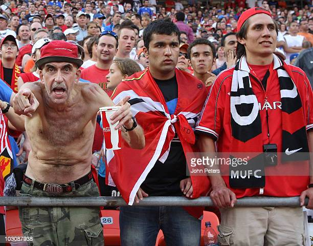 Fans of Manchester United and Kansas City Wizards watch from the stands during the preseason friendly match between Kansas City Wizards and...
