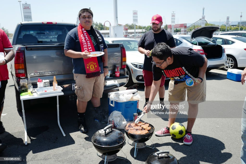 Fans of Manchester United cook BBQ food during a tailgate party priori to the Pre-Season match between Manchester United v San Jose Earthquakes at Levi's Stadium on July 22, 2018 in Santa Clara, California.