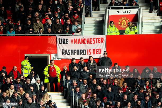 Fans of Manchester United look on as banner which reads Like Manchester Rashford is Red is seen during the Premier League match between Manchester...