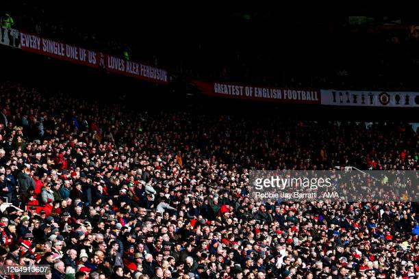 Fans of Manchester United look on during the Premier League match between Manchester United and Watford FC at Old Trafford on February 23 2020 in...