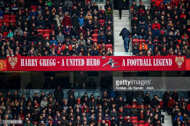 Fans of Manchester United pay their respects to former player Harry Gregg during the Premier League match between Manchester United and Watford FC at...