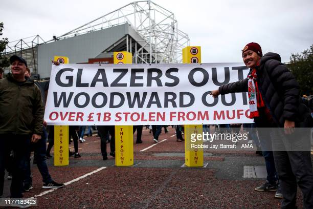 Fans of Manchester United protest against the owners of Manchester United the Glazers and Chief Executive Ed Woodward prior to the Premier League...