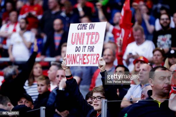 Fans of Manchester United with a sign during the UEFA Europa League Final between Ajax and Manchester United at Friends Arena on May 24 2017 in...