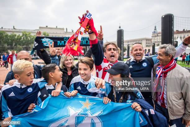 Fans of Marseille and Atletico celebrate at the Fan Zone ahead of the UEFA Europa League Final between Olympique de Marseille and Club Atletico de...