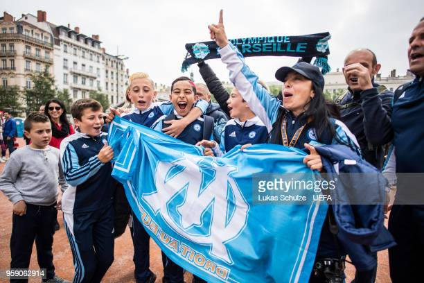 Fans of Marseille celebrate at the Fan Zone ahead of the UEFA Europa League Final between Olympique de Marseille and Club Atletico de Madrid at Stade...