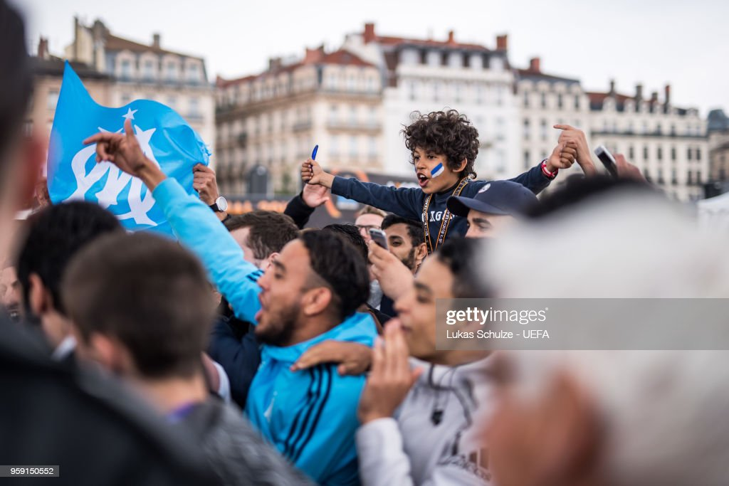 Fans of Marseille celebrate at the Fan Zone ahead of the UEFA Europa League Final between Olympique de Marseille and Club Atletico de Madrid at Stade de Lyon on May 15, 2018 in Lyon, France.