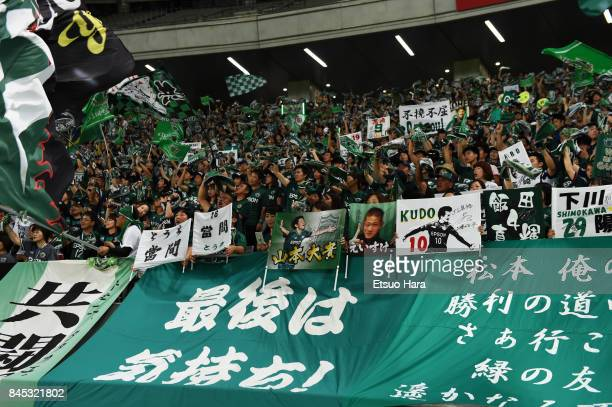 Fans of Matsumoto Yamaga cheer after the JLeague J2 match between Tokyo Verdy and Matsumoto Yamaga at Ajinomoto Stadium on September 10 2017 in Chofu...