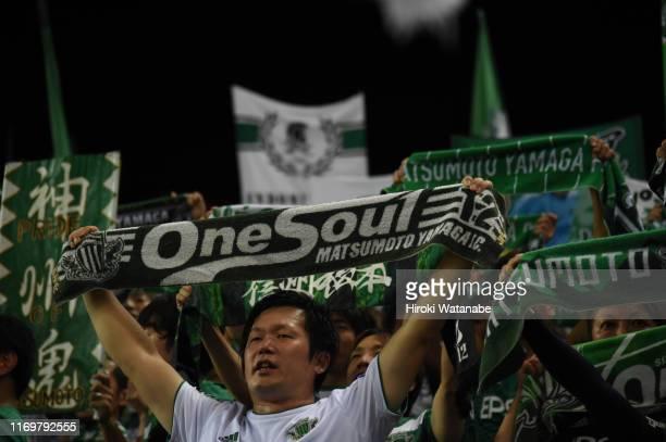 Fans of Matsumoto Yamaga cheer prior to the J.League J1 match between Urawa Red Diamonds and Matsumoto Yamaga at Saitama Stadium on August 23, 2019...